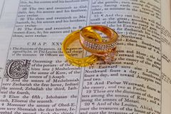 Free November 04 2016 Wedding Rings Place On An Open Bible To A Verse In The Book Of Genesis Marriage. Royalty Free Stock Photography - 117346227