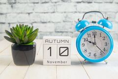 Free November 10 On The Wooden Calendar.The Tenth Day Of The Autumn Month, A Calendar For The Workplace. Autumn Stock Image - 183218751