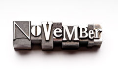 November. The month of November done in letterpress type on a white paper background