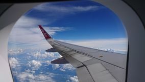 2017 November 20 : Air asia flights from Chiang Rai CEI - Chiang Rai Intl to Bangkok DMK - Don Mueang Intl. On sky. view from window seat passenger. take photo Stock Photos