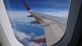 2017 November 20 : Air asia flights from Chiang Rai CEI - Chiang Rai Intl to Bangkok DMK - Don Mueang Intl. On sky. view from window seat passenger. take photo Stock Photos