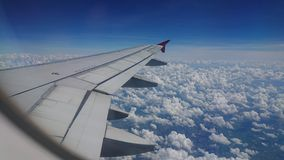 2017 November 20 : Air asia flights from Chiang Rai CEI - Chiang Rai Intl to Bangkok DMK - Don Mueang Intl. On sky. view from window seat passenger. take photo Royalty Free Stock Photo