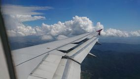 2017 November 20 : Air asia flights from Chiang Rai CEI - Chiang Rai Intl to Bangkok DMK - Don Mueang Intl. On sky. view from window seat passenger. take photo Stock Image