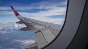 2017 November 20 : Air asia flights from Chiang Rai CEI - Chiang Rai Intl to Bangkok DMK - Don Mueang Intl. On sky. view from window seat passenger. take photo Royalty Free Stock Image