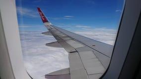 2017 November 20 : Air asia flights from Chiang Rai CEI - Chiang Rai Intl to Bangkok DMK - Don Mueang Intl. On sky. view from window seat passenger. take photo Royalty Free Stock Photos