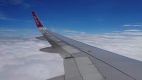 2017 November 20 : Air asia flights from Chiang Rai CEI - Chiang Rai Intl to Bangkok DMK - Don Mueang Intl. On sky. view from window seat passenger. take photo Royalty Free Stock Photo