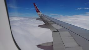 2017 November 20 : Air asia flights from Chiang Rai CEI - Chiang Rai Intl to Bangkok DMK - Don Mueang Intl. On sky. view from window seat passenger. take photo Stock Images