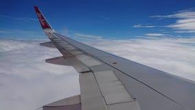 2017 November 20 : Air asia flights from Chiang Rai CEI - Chiang Rai Intl to Bangkok DMK - Don Mueang Intl. On sky. view from window seat passenger. take photo Royalty Free Stock Photography