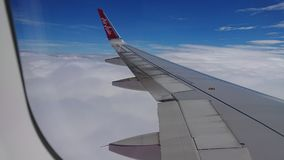 2017 November 20 : Air asia flights from Chiang Rai CEI - Chiang Rai Intl to Bangkok DMK - Don Mueang Intl. On sky. view from window seat passenger. take photo Royalty Free Stock Images