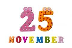 25. November auf weißem Hintergrund, Zahlen und Buchstaben Lizenzfreie Stockbilder