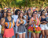 27 November, 2016. Beautiful women in short skirts and shorts pl. Aying percussions and dancing in the street at Festival de Fanfarras Ativistas - HONK RiO 2016 stock image