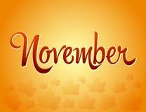 November-Beschriftung und gefallene Blätter Stockbild