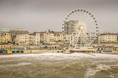 Dangerous waves threaten promenade and big wheel. Stock Photography