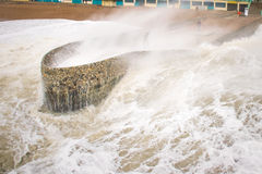 Man caught by storm Desmond waves  Royalty Free Stock Photography