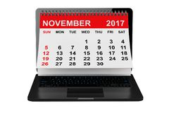 November 2017 calendar over laptop screen. 3d rendering. 2017 year calendar. November calendar over laptop screen on a white background. 3d rendering Royalty Free Stock Photos