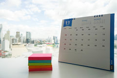 November calendar with stack of sticky note royalty free stock photo