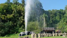 Fang Hot Spring, Chiangmai, Thailand. A geyser erupts from underground.