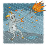November goat. Grumpy goat fighting with umbrella Royalty Free Stock Photo