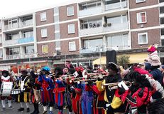 24-November-2018, The Hague, Netherlands, Europe. Celebrating the arrival of Dutch Saint Nicholas, called Sinterklaas, with his as. People dressed up in costume stock photos