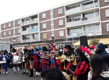 24-November-2018, The Hague, Netherlands, Europe. Celebrating the arrival of Dutch Saint Nicholas, called Sinterklaas, with his as. People dressed up in costume stock photo