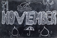 November handgeschrieben auf Tafel Stockbilder