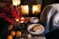 November home. Still life from a november evening with tea , cake, fire and candles stock photo