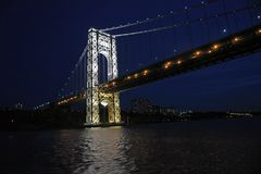 November 11, 2007, The Hudson River, Near Inwood Park, New York City.  The Brightly Lit East Tower of The George Washington Bridge Stock Images