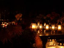 November- light and memory. Candles, candles, light and flowers, evidence of the memory of those who passed away Royalty Free Stock Photos