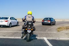 Motorcyclist riding on a highway, San Francisco bay area stock images