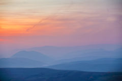 November misty sunset in mountains Royalty Free Stock Images
