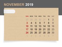 November 2019 - Monthly calendar on brown paper and wood background. November 2019 - Monthly calendar on brown paper and wood background with area for note royalty free illustration