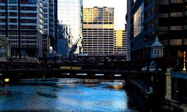 Morning light over the Chicago River during early rush hour. November morning in Chicago with sunlight over Chicago River and view of Monroe Street bridge Stock Images