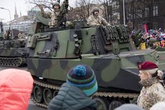 NATO tanks and soldiers at military parade in Riga, Latvia. November 18, 2017. Parade in honor of proclamation of Latvia at November 18 for the Independence Day stock images