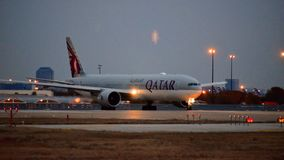 Qatar Airlines Boeing 777 airplane one the taxi way. stock image