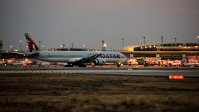 Qatar Airlines Boeing 777 airplane one the taxi way. stock photography