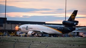 UPS MD-11 airplane on the ground at the gate. stock photography