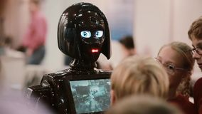 NOVEMBER 5, 2016 RUSSIA, MOSCOW Robotics Expo. Close up of girl robot KIKI face in crowd,talking to visitors, show video stock video footage