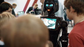NOVEMBER 5, 2016 RUSSIA, MOSCOW Robotics Expo.Girl robot KIKI in crowd, talking to visitors, show video on screen. 4K stock footage