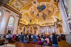 November 25, 2018 San Jose / CA / USA - People attending mass a royalty free stock image