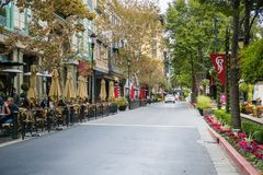 Street lined up with cafes in the European style inspired shopping district Santana Row, San Jpse, California. November 8, 2017 San Jose/CA/USA - Street lined up royalty free stock photography