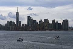 November 2018 - Skyline of Manhattan, New York City, view from Liberty Island, ferry boat on the ocean stock images