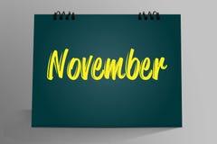 November som är skriftlig i skrivbords- kalender Arkivfoto