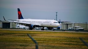 Delta Airlines airplane on the runway royalty free stock photos
