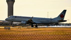 Air Canada Airlines airplane landing on a runway with tires smoking stock photography