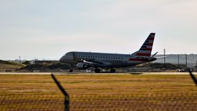 American Eagle Airlines airplane landing on a runway stock photo