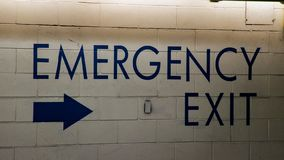 Emergency Exit on Wall royalty free stock photo