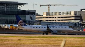 United Express ERJ170 on the taxi way preparing to take off stock image