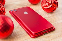 November 2017. Two smartphones Apple Iphone 7. Two smartphones Apple iphone 7 red are lying next to the Christmas balls Stock Photo