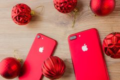 November 2017. Two smartphones Apple Iphone 7. Two smartphones Apple iphone 7 red are lying next to the Christmas balls.n Royalty Free Stock Images