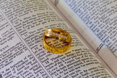 November 04 2016 Two wedding rings on a bible. Wedding rings Bible Royalty Free Stock Images